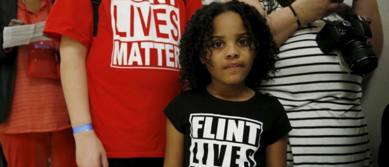 """Mari Copeny, 8, of Flint, Michigan, waits in line to enter a hearing room where Michigan Governor Rick Snyder (R) and EPA Administrator Gina McCarthy will testify before a House Oversight and government Reform hearing on """"Examining Federal Administration of the Safe Drinking Water Act in Flint, Michigan, Part III"""" on Capitol Hill in Washington March 17, 2016. REUTERS/Kevin Lamarque"""