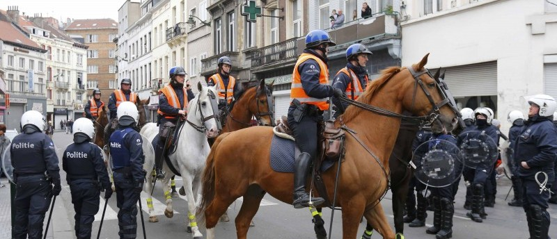 Mounted Belgian police take position in the Brussels district of Molenbeek
