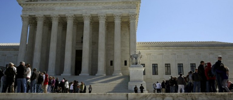 People line up to visit the U.S. Supreme Court in Washington March 29, 2016.