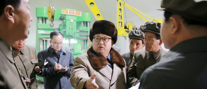 North Korean leader Kim Jong Un (C) speaks during a visit to the Sinhung Machine Plant in this undated photo released by North Korea's Korean Central News Agency (KCNA) in Pyongyang April 1, 2016.   REUTERS/KCNA