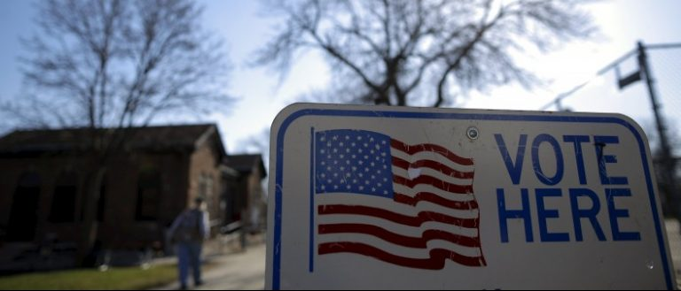 A voter arrives to cast their ballot in the Wisconsin presidential primary election at a voting station in Milwaukee