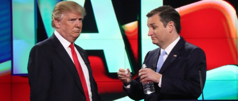 Republican presidential candidate Donald Trump talks with rival Ted Cruz during a commercial break in the midst of the Republican presidential candidates debate sponsored by CNN at the University of Miami in Miami, Florida March 10, 2016. REUTERS/Carlo Allegri