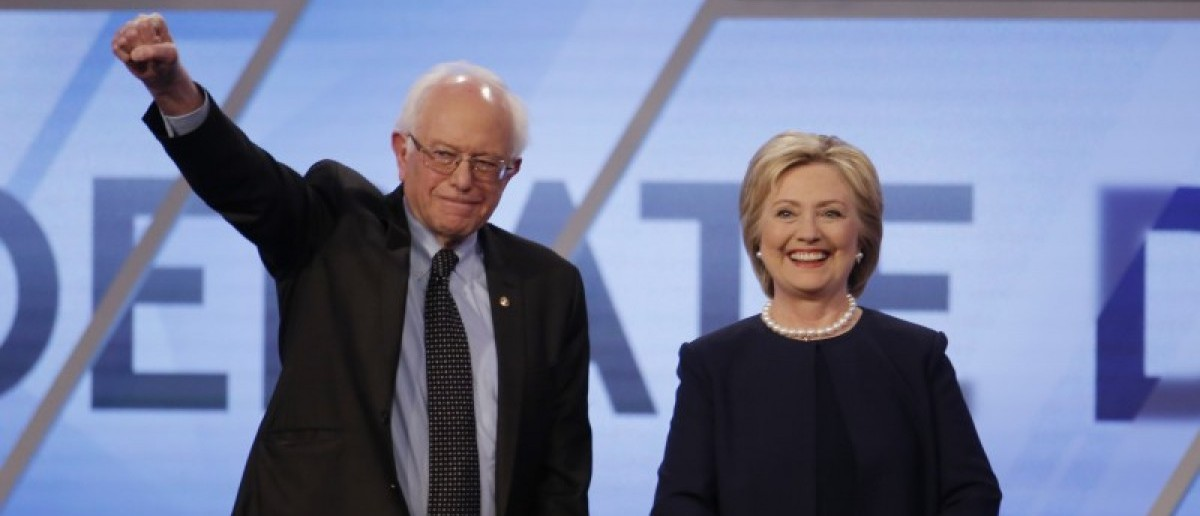 Democratic U.S. presidential candidates Senator Bernie Sanders and Hillary Clinton pose before the start of the Univision News and Washington Post Democratic U.S. presidential candidates debate in Kendall