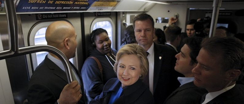 U.S. Democratic presidential candidate Hillary Clinton rides the New York City Subway in the Bronx borough of New York, April 7, 2016. REUTERS/Brendan McDermid