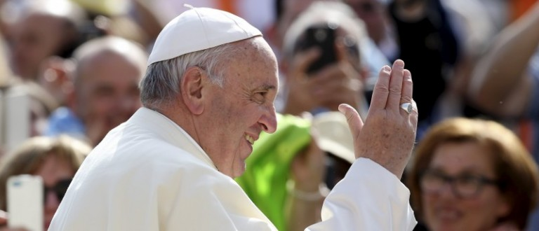 Pope Francis arrives to lead the weekly audience in Saint Peter's Square at the Vatican