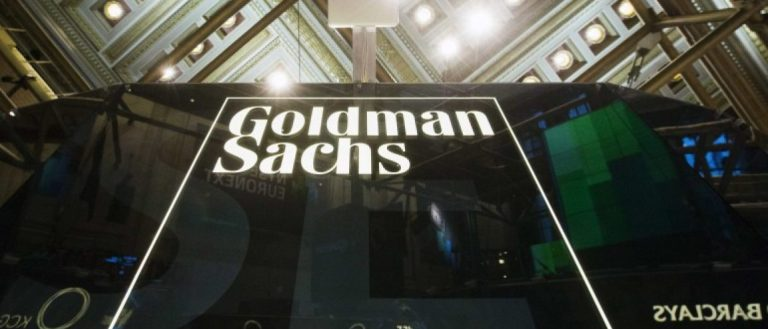 A Goldman Sachs sign is seen above the floor of the New York Stock Exchange shortly after the opening bell in New York, in this file photo taken January 24, 2014. REUTERS/Lucas Jackson/Files