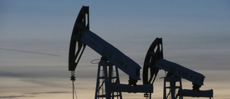 Pump jacks are seen at the Lukoil-owned Imilorskoye oil field, as the sun sets, outside the west Siberian city of Kogalym, Russia, in this January 25, 2016 file photo. To match Exclusive RUSSIA-OPEC/FREEZE REUTERS/Sergei Karpukhin/Files - RTSDS3E