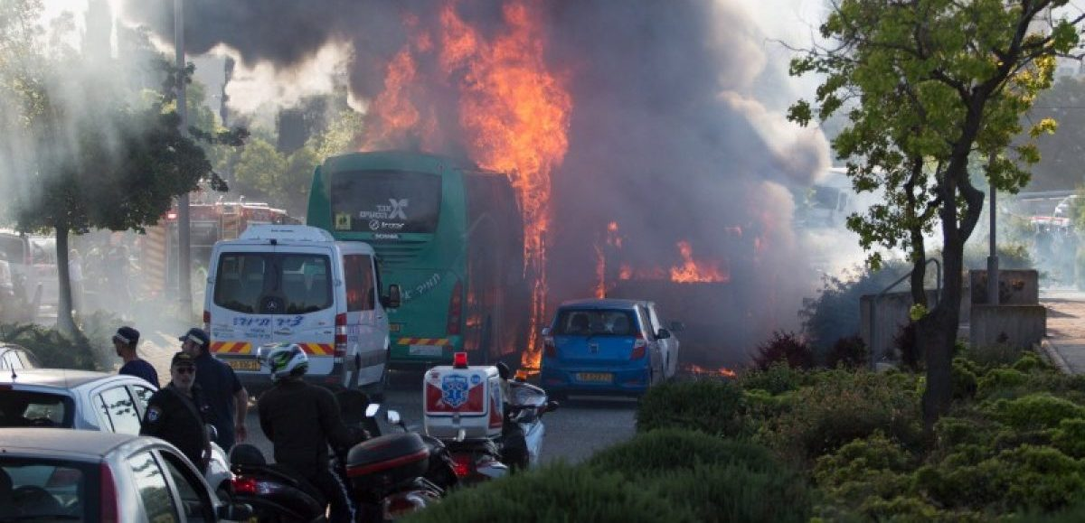 Flames rise at the scene where an explosion tore through a bus in Jerusalem