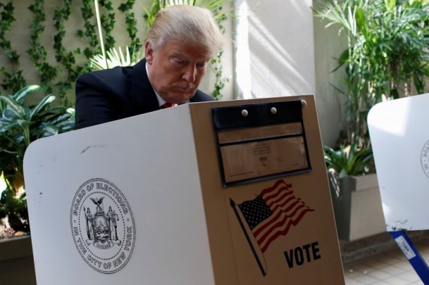 Republican presidential candidate Donald Trump fills his ballot for the New York primary election in the Manhattan borough of New York City