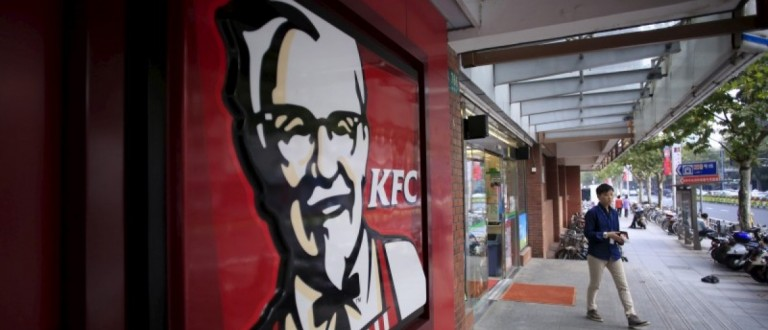 A customer walks out of a KFC restaurant in Shanghai, China, October 9, 2015.
