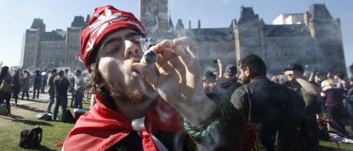 A man smokes marijuana during an annual 4/20 rally on Parliament Hill in Ottawa, Canada, April 20, 2016. REUTERS/Chris Wattie