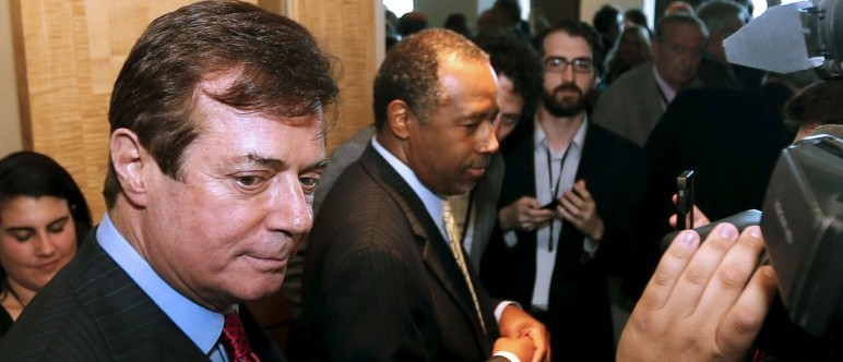 U.S. presidential candidate Donald Trump's senior campaign adviser Paul Manafort (L) answers a question from a reporter as he walked into a reception with former Republican presidential candidate Dr. Ben Carson, (C), at the Republican National Committee Spring Meeting at the Diplomat Resort in Hollywood, Florida, April 21, 2016. REUTERS/Joe Skipper