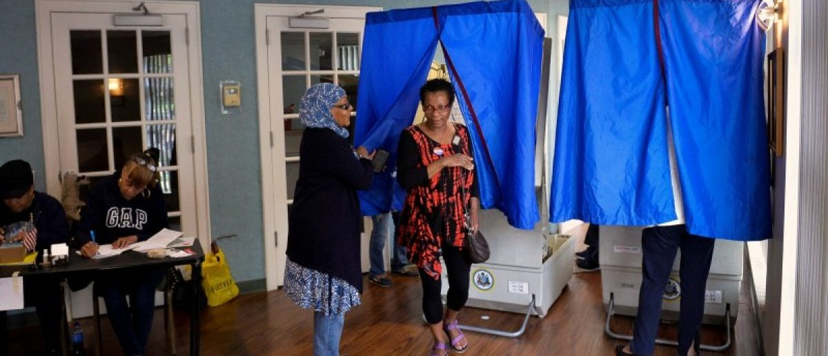 A voter exits the voting booth after casting her ballot in the Pennsylvania primary at the Kimble Funeral Home polling place in Philadelphia, Pennsylvania, U.S., April 26, 2016. REUTERS/Charles Mostoller