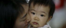 Jeong Bo-mi, 37, among a group of South Korean parents who sued a post-partum care centre seeking compensation after babies were infected with latent tuberculosis, takes care of her baby, who was not infected but was treated as a preventive measure, at her home in Seoul, South Korea, April 7, 2016. REUTERS/Kim Hong-Ji