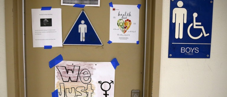 A protest sign on a bathroom which helped lobby for the first gender-neutral restroom in the Los Angeles school district is seen at Santee Education Complex high school in Los Angeles