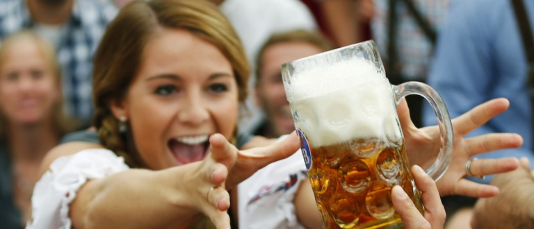 File photo of a visitor reaching for of the one of the first mugs of beer after the tapping of the first barrel during the opening ceremony for the 180th Munich Oktoberfest