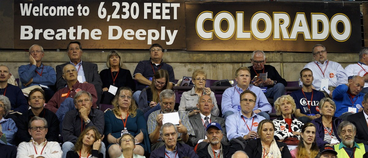 Attendees at the Colorado Republican state convention listen to a speaker at the event in Colorado Springs, Colorado