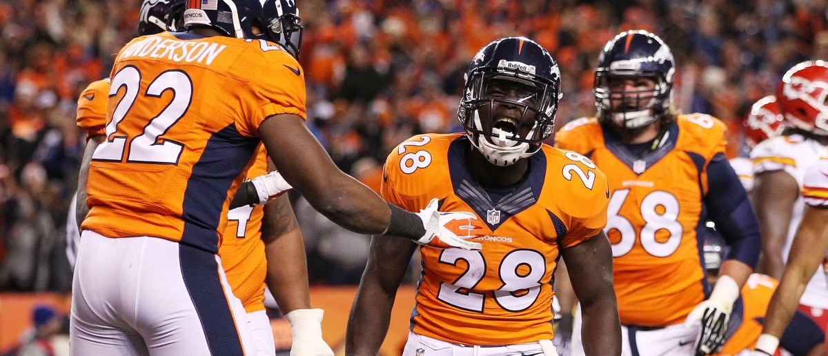 Montee Ball #28 of the Denver Broncos celebrates scoring a second quarter touchdown with C.J. Anderson and Orlando Franklin #74 against the Kansas City Chiefs at Sports Authority Field at Mile High