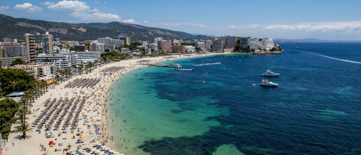 Tourist sunbathe at Magaluf beach on July 13, 2014 in Mallorca, Spain. (David Ramos/Getty Images)