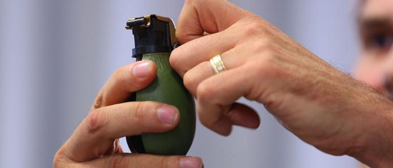 German policeman Andreas Stenger holding a hand grenade [Thomas Niedermueller/Getty Images]
