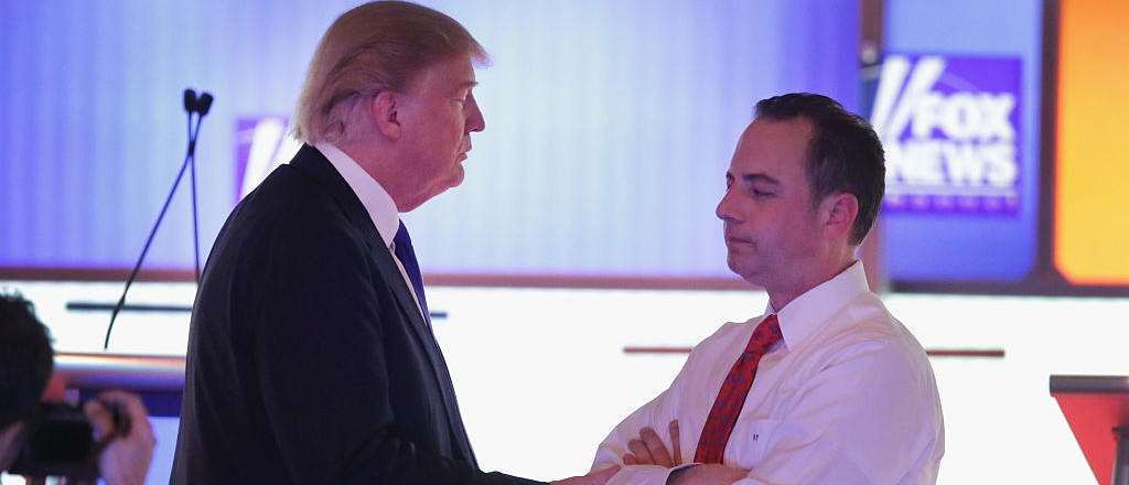Republican presidential candidate Donald Trump (L) speaks with Reince Priebus, chairman of the Republican National Committee, at a debate sponsored by Fox News at the Fox Theatre on March 3, 2016 in Detroit, Michigan