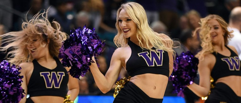 LAS VEGAS, NV - MARCH 10: Washington Huskies cheerleaders perform during the team's quarterfinal game of the Pac-12 Basketball Tournament against the Oregon Ducks at MGM Grand Garden Arena on March 10, 2016 in Las Vegas, Nevada. Oregon won 83-77. (Photo by Ethan Miller/Getty Images)