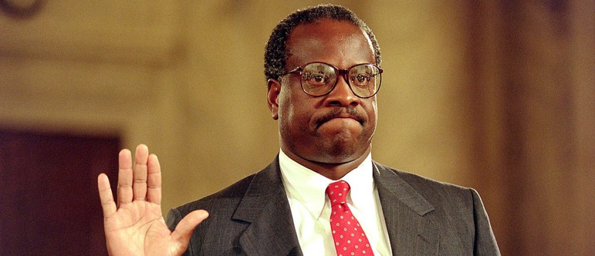 WASHINGTON, DC - SEPTEMBER 10: US Supreme Court nominee Clarence Thomas raises his right hand as he is sworn in, 10 September 1991, during confirmation hearings before the US Senate Judiciary Committee, in Washington D.C.. US law professor Anita Hill filed sexual harassment charges against US Supreme Court nominee Clarence Thomas. (Photo credit should read J. DAVID AKE/AFP/Getty Images)