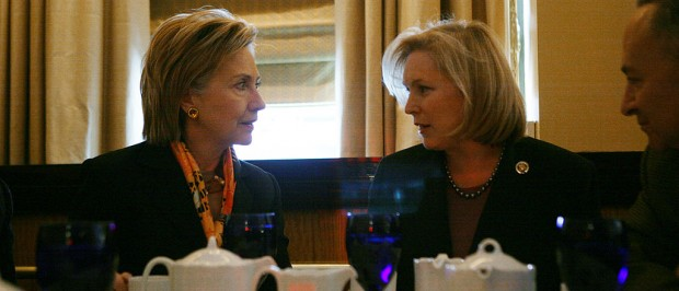 Then-Senator-designate Rep. Kirsten Gillibrand (D-NY) (R) and U.S. Secretary of State Hillary Rodham Clinton look to each other during a lunch meeting with New York Gov. David A. Paterson and U.S. Sen. Charles Schumer (D-NY) (R) at Waldorf-Astoria Hotel on Jan. 25, 2009 in New York City. (Photo by Hiroko Masuike/Getty Images)