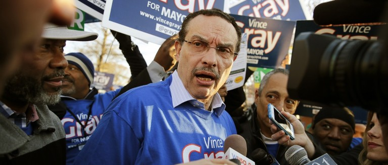 Washington D.C. Mayor Vincent Gray talks to the media outside the precinct 65 polling place on the Lasalle-Backus Education Campus, in Washington, April 1, 2014. District of Columbia voters head to the polls on Tuesday for a crowded Democratic mayoral primary, with the incumbent facing a strong threat from a city councilor after being linked to a campaign-finance scandal. REUTERS/Jim Bourg