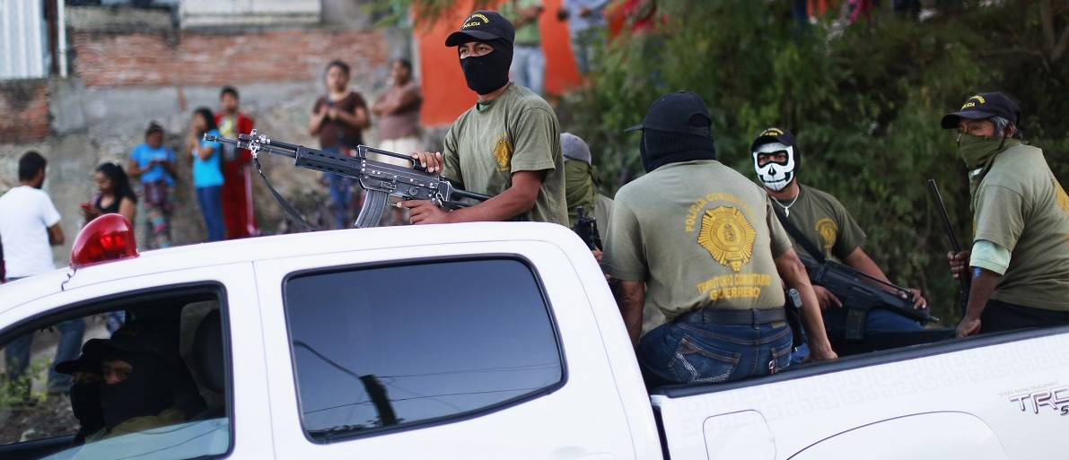 Members of the community police of Guerrero arrive to show their support at a demonstration to demand justice for the 43 missing trainee teachers of the Ayotzinapa Teacher Training College Raul Isidro Burgos, in Tixtla