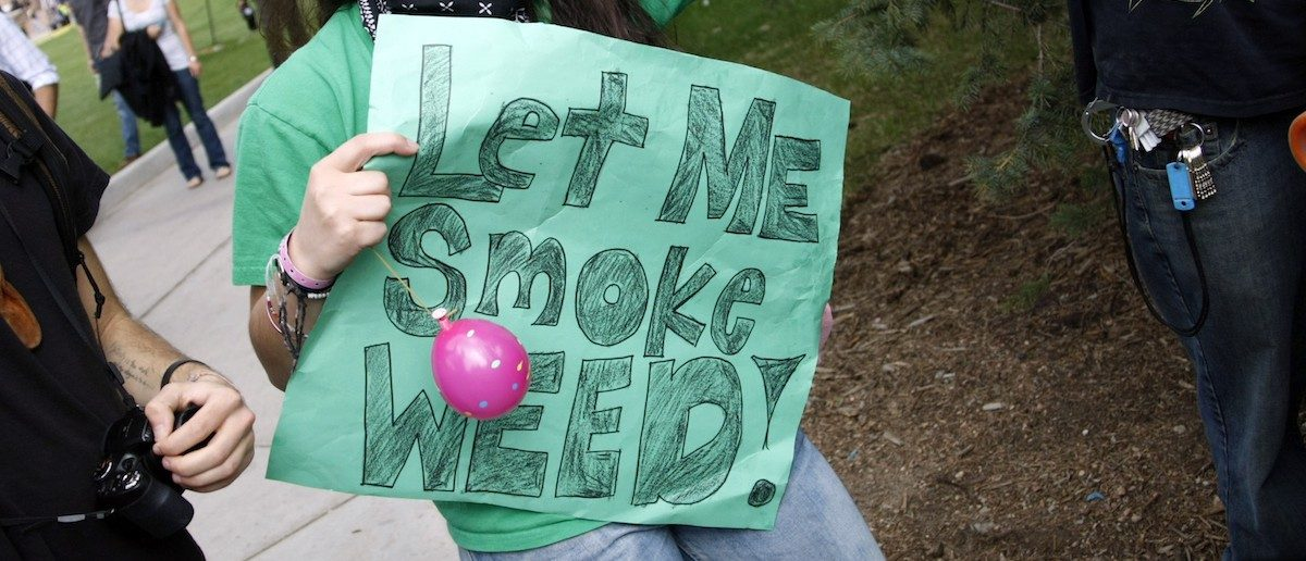 "A woman holds a sign at a pro-marijuana rally at the University of Colorado in Boulder, Colorado April 20, 2012. The University of Colorado clamped down on a huge annual marijuana fest on Friday by restricting access to the school and a field where the ""smoke-in"" is traditionally held, and three protesters were arrested ahead of the event. The event was held on April 20, a date corresponding with a numerical 4/20 code widely known within the cannabis subculture as a symbol for all things marijuana. REUTERS/Rick Wilking"