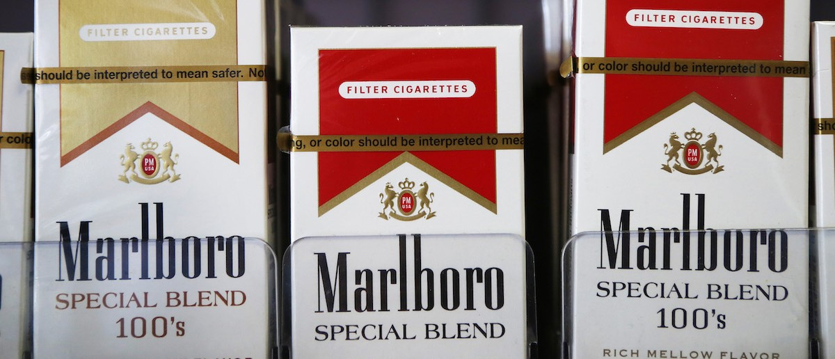 """Packs of Marlboro cigarettes are displayed for sale at a convenience store in Somerville, Massachusetts July 17, 2014. Cigarette maker Philip Morris International Inc cut its earnings forecast for 2014 and said it is proving to be a """"complex and truly atypical"""" year for the company. REUTERS/Brian Snyder"""