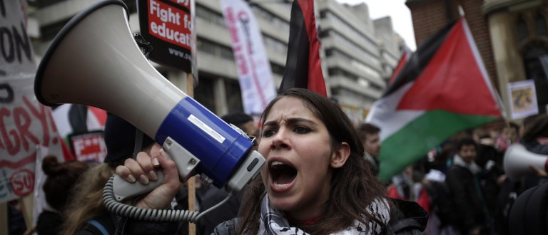 Protesters gather to demonstrate against education cuts, tuition increases and austerity on November 21, 2012 in London, England. (Warrick Page/Getty Images)