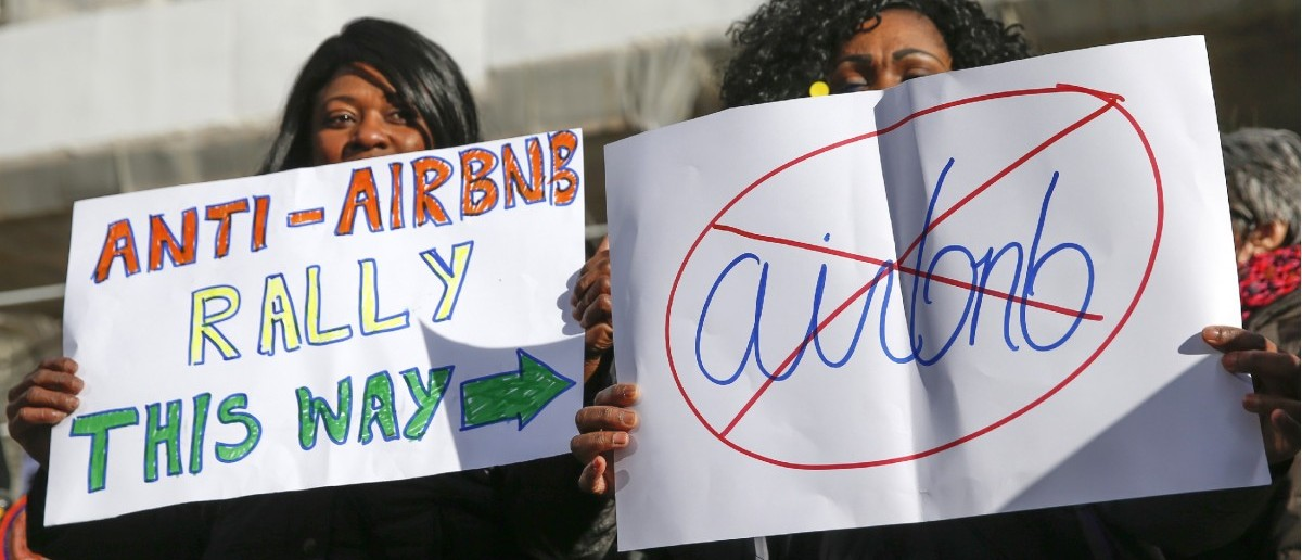 Opponents of Airbnb rally (REUTERS/Shannon Stapleton)