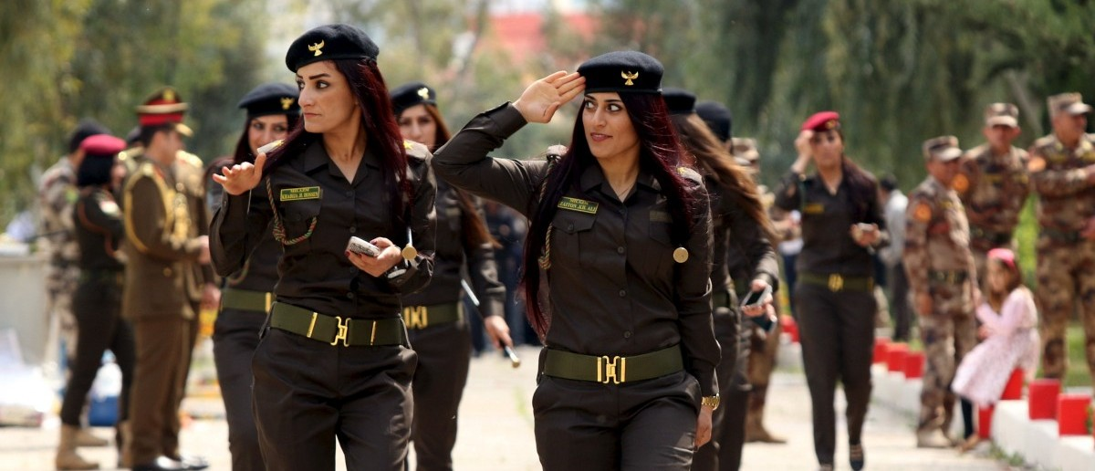 Female Kurdish Peshmerga attend their graduation ceremony at a police academy in Zakho district of the Dohuk Governorate of the Iraqi Kurdistan province, Iraq, March 30, 2016. REUTERS/Ari Jalal