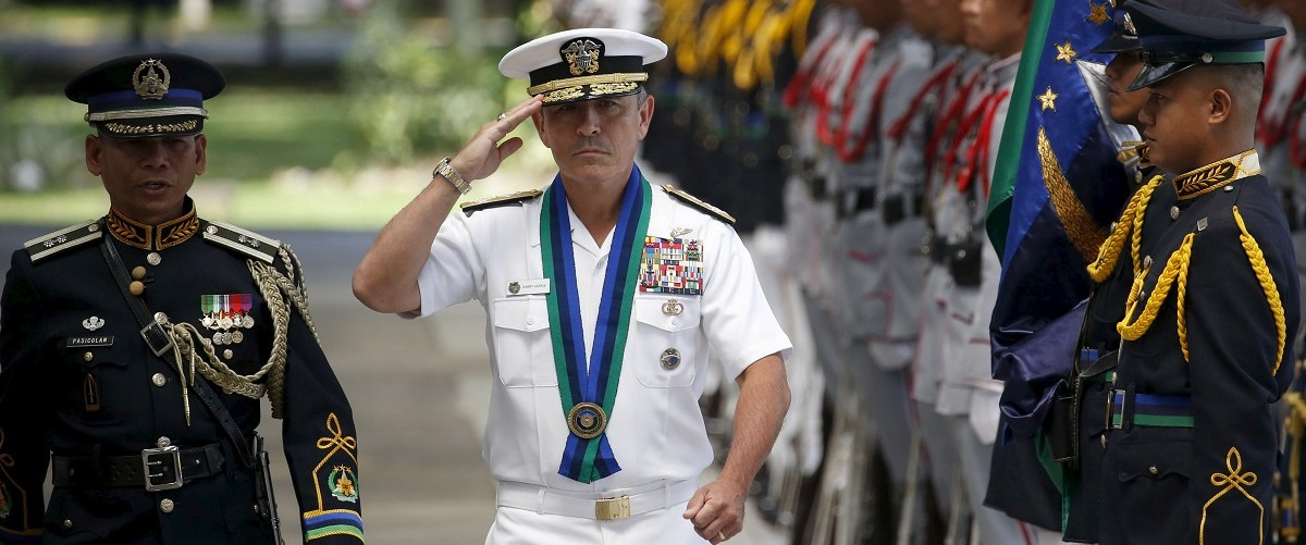 U.S. Navy Admiral Harry Harris, Commander of the U.S. Pacific Fleet, salutes during a welcome ceremony at the Philippine Armed Forces headquarters at Camp Aguinaldo in Quezon City