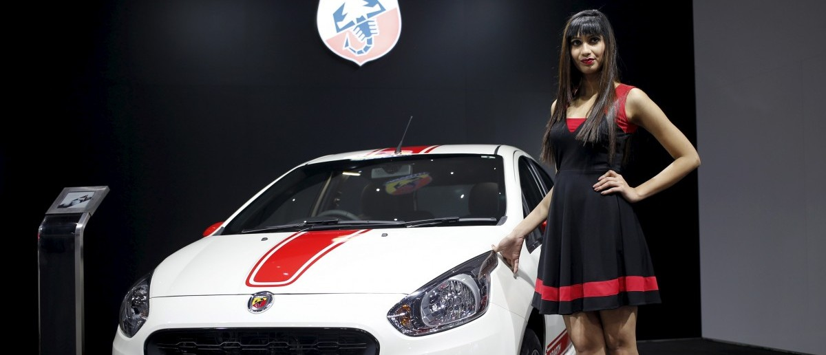 A model poses next to a Fiat Abarth car (REUTERS/Anindito Mukherjee)