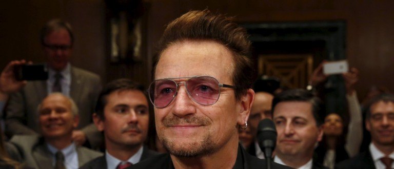 """U2 lead singer Bono attends a Senate Appropriations State, Foreign Operations and Related Programs Subcommittee hearing on """"Causes and consequences of violent extremism and the role of foreign assistance"""" on Capitol Hill in Washington April 12, 2016. REUTERS/Yuri Gripas"""