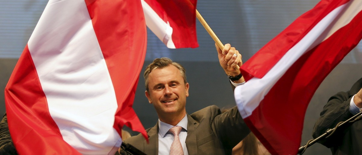 Austrian far right Freedom Party (FPOe) presidential candidate Norbert Hofer waves with Austrian flags during the final election rally in Vienna, Austria, April 22, 2016. REUTERS/Leonhard