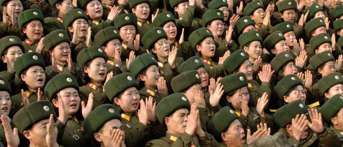 North Korean soldiers applaud during its leader Kim Jong-il's visit to the 324 military unit at the undisclosed place in North Korea, in this undated picture released by North Korea's official news agency KCNA February 7, 2009. KCNA did not state expressly the date when the picture was taken. North Korea wants to advance nuclear disarmament steps if its aid demands are met and it played down concerns over possible missile launches, a former senior U.S. diplomat just back from Pyongyang said on Saturday.  REUTERS/KCNA