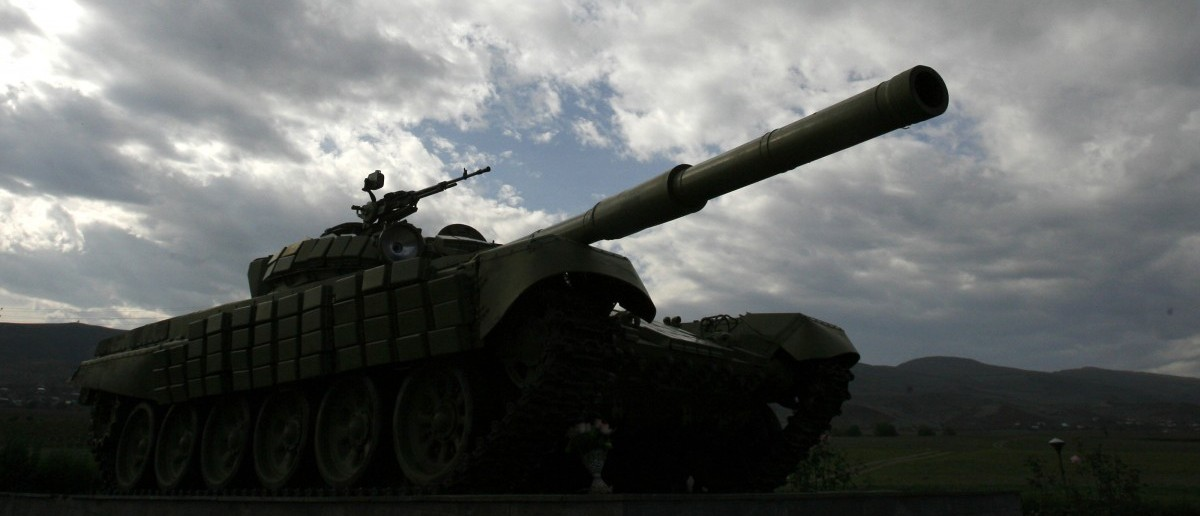 A Soviet-made tank is seen near the town of Agdam, controlled by Nagorno Karabakh, and which was completely destroyed during fighting between Karabakh and Azerbaijan forces in 1990s, October 29, 2009. Largely forgotten by the outside world, the remote territory is now the centre of diplomatic attention because it could torpedo a fragile peace deal between historic enemies Armenia and Turkey. Picture taken October 29, 2009. To match feature ARMENIA-AZERBAIJAN/KARABAKH  REUTERS/David Mdzinarishvili
