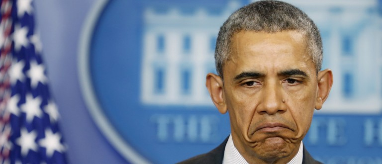 U.S. President Barack Obama reacts to question while speaking in the White House briefing room in Washington