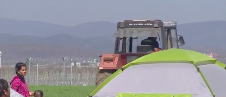 A Greek farmer plow through refugee tents on his fields. (Ruptly/YouTube)