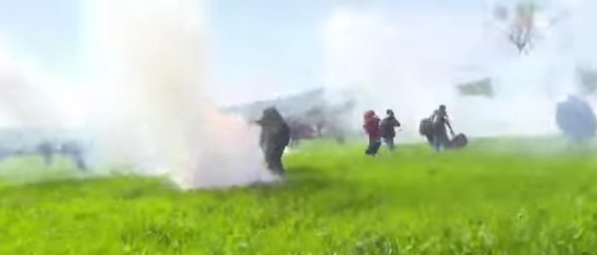 Migrants clash with police along Greece-Macedonian border. (YouTube screenshot/Ruptly)