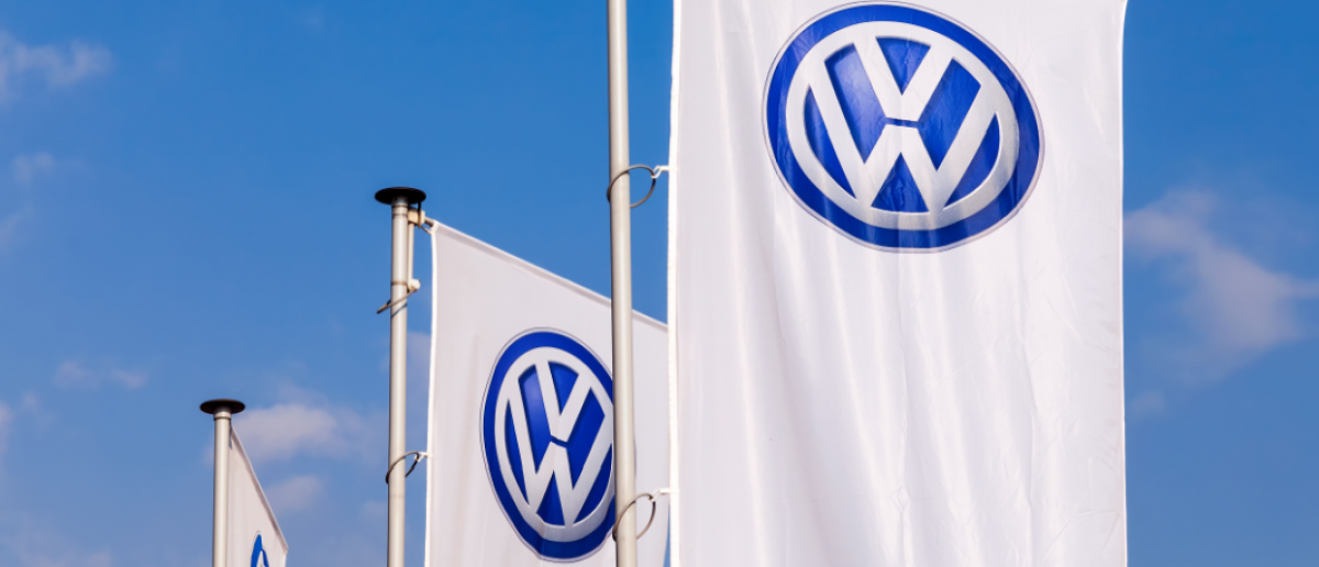 SEPTEMBER 21, 2014: The flags of Volkswagen over blue sky. Volkswagen is the biggest German automaker and the third largest automaker in the world (FotograFFF / Shutterstock.com)