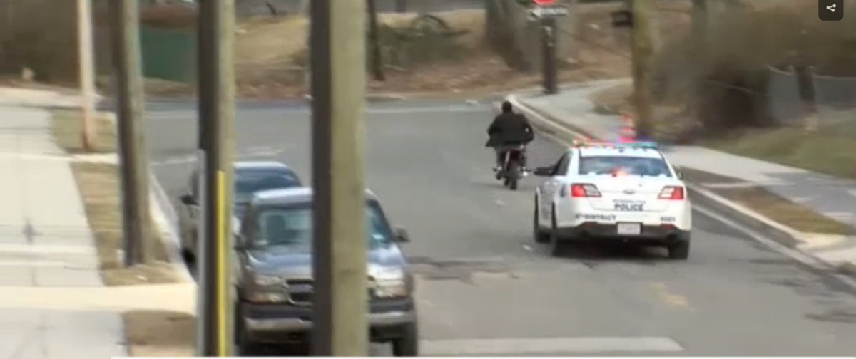 Dirt-bike rider evades DC police. (Screenshot/YouTube/WJLA)