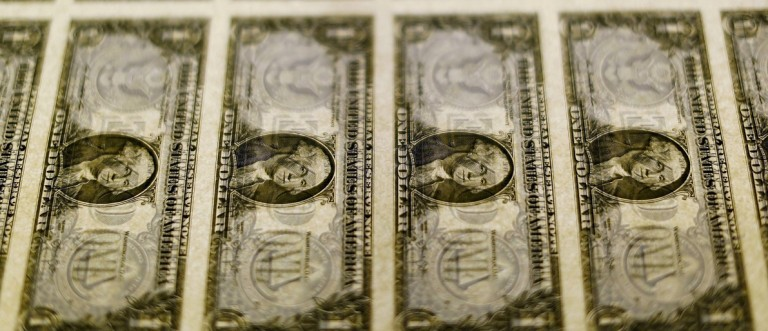 File photo of United States one dollar bills seen on a light table at the Bureau of Engraving and Printing in Washington