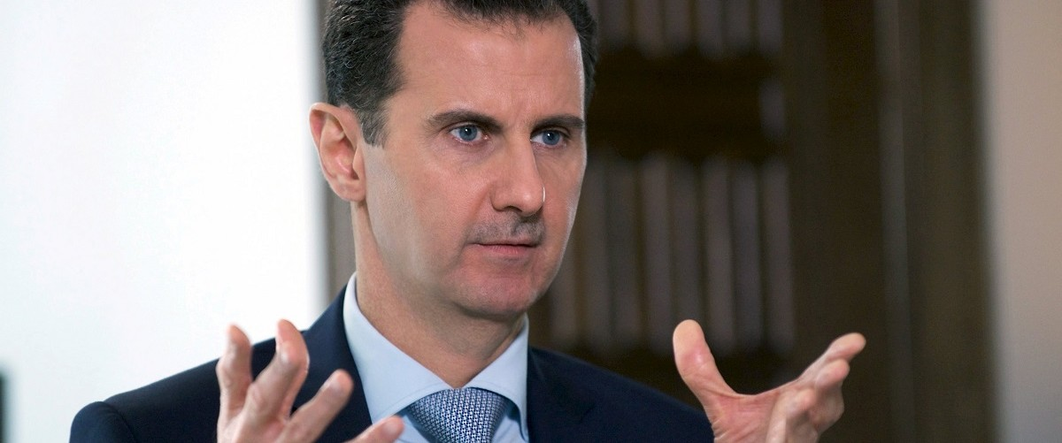 File photo of Syria's President Bashar al-Assad speaking during an interview with Russia's RIA new agency