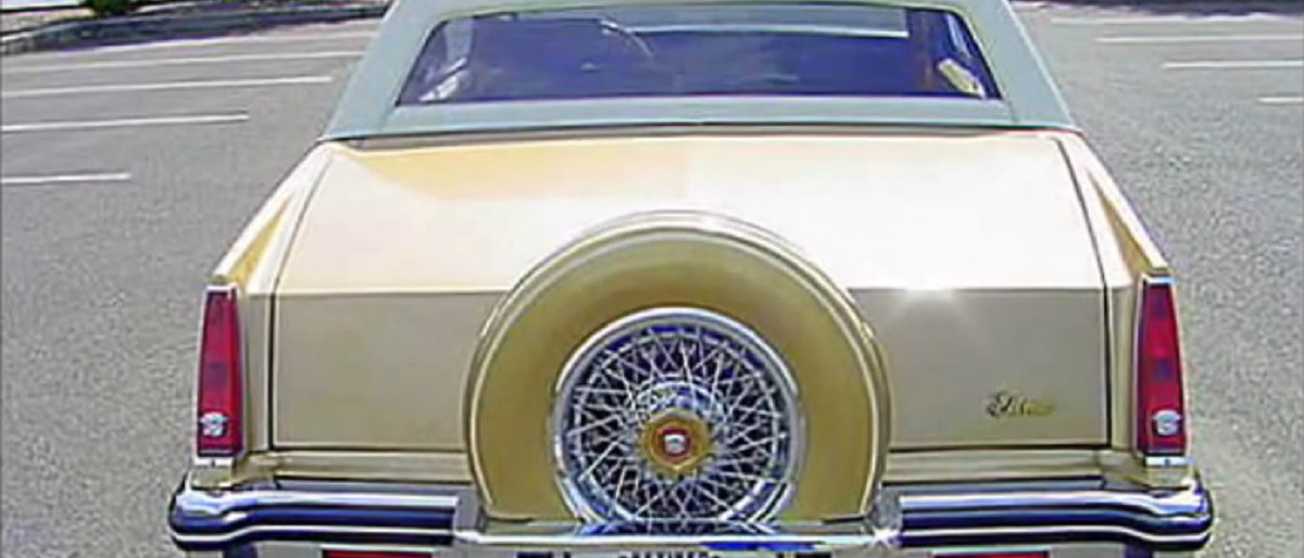 gold Cadillac YouTube screenshot/fabulous50scars