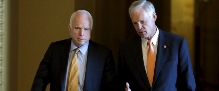 Senators McCain and Johnson walk to weekly luncheon at the U.S. Capitol in Washington